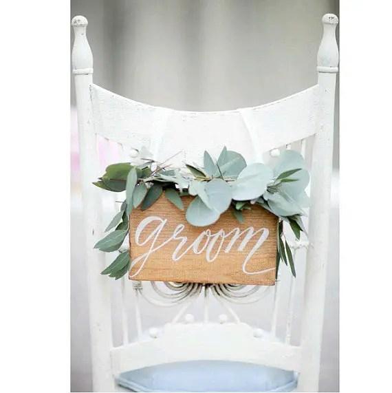groom chair sign   via http://emmalinebride.com/decor/bride-and-groom-chairs/