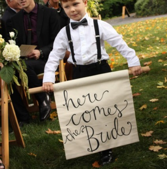 here comes the bride banner | via Rustic Ring Pillows http://emmalinebride.com/ceremony/rustic-ring-pillows/