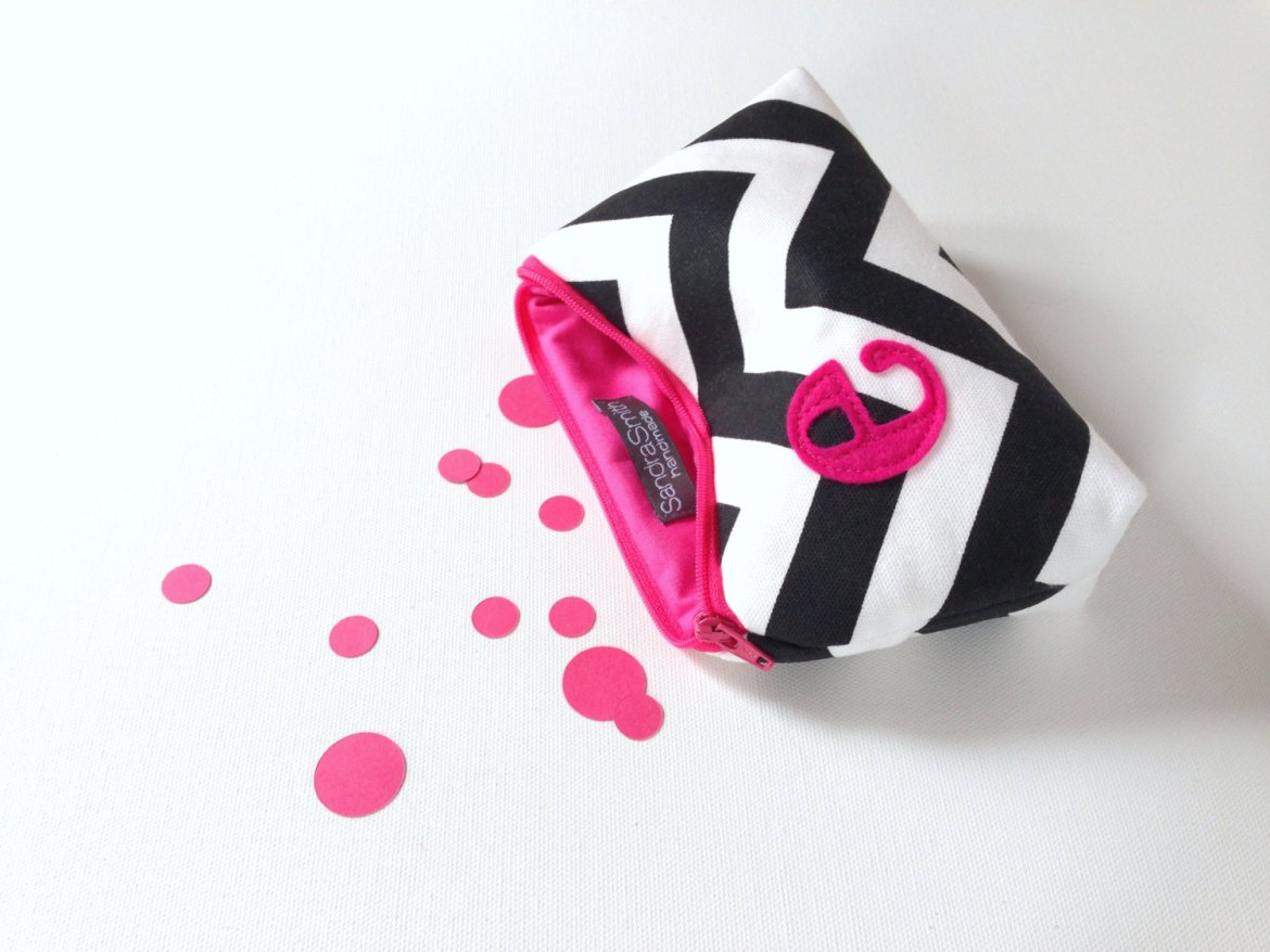 hot pink and black cosmetic bag by sandra smith handmade | fun bachelorette party ideas | http://emmalinebride.com/planning/fun-bachelorette-party-ideas/
