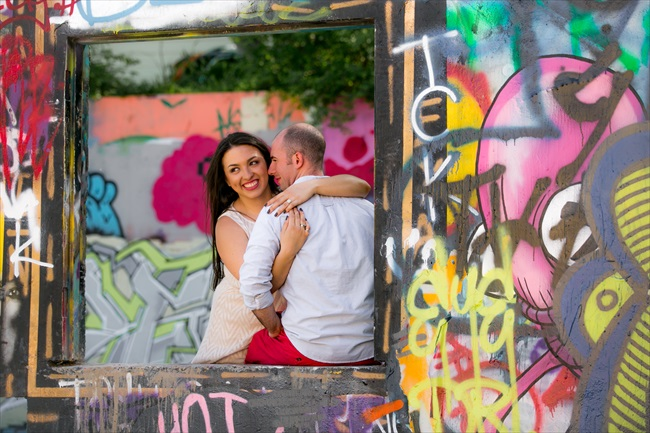 couple takes photo by graffiti at their Fun Austin Engagement Session   Photographer: Adrianne Riley Photography   via http://emmalinebride.com/real-weddings/fun-austin-engagement-session-priscella-jerry/