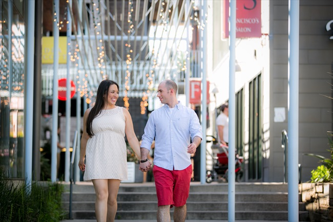 couple walks in downtown at their Fun Austin Engagement Session | Photographer: Adrianne Riley Photography | via http://emmalinebride.com/real-weddings/fun-austin-engagement-session-priscella-jerry/