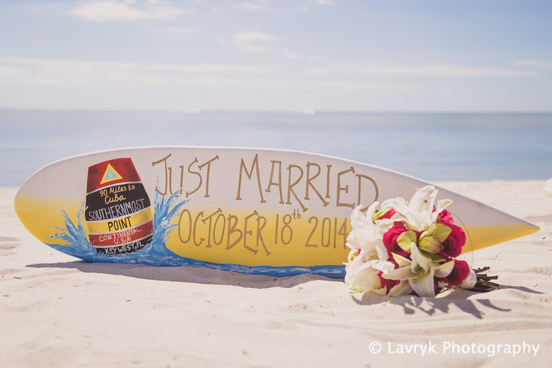 just married surfboard via how to decorate for beach wedding via emmalinebride.com