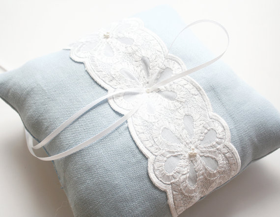 light blue lace ring pillow via 8 Chic Linen Ring Pillows