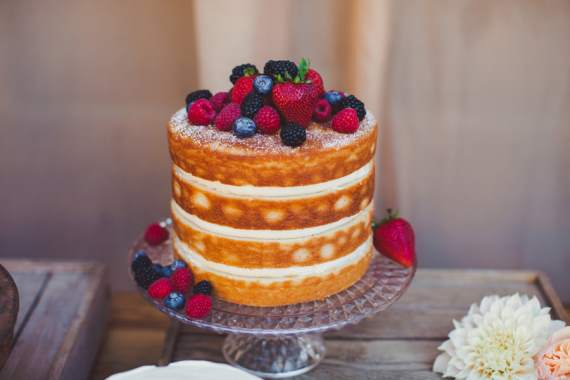 Naked Wedding Cakes | This cake has strawberries and blueberries, which add color and texture to this natural cake.  This type of cake is ideal in the summer when fresh fruit is in season.