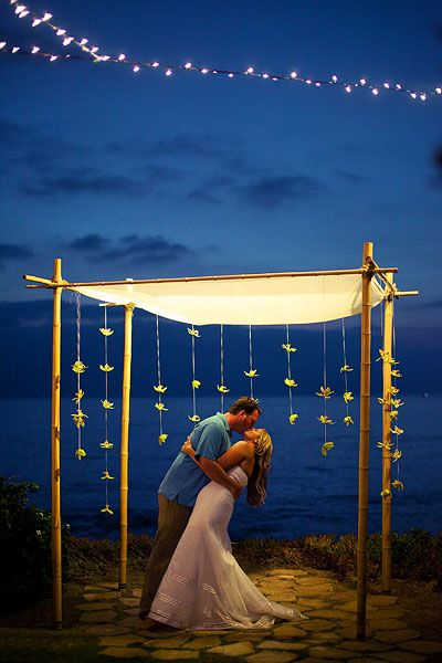 Oceanfront View With Glowing Arbor   Night Wedding Ideas