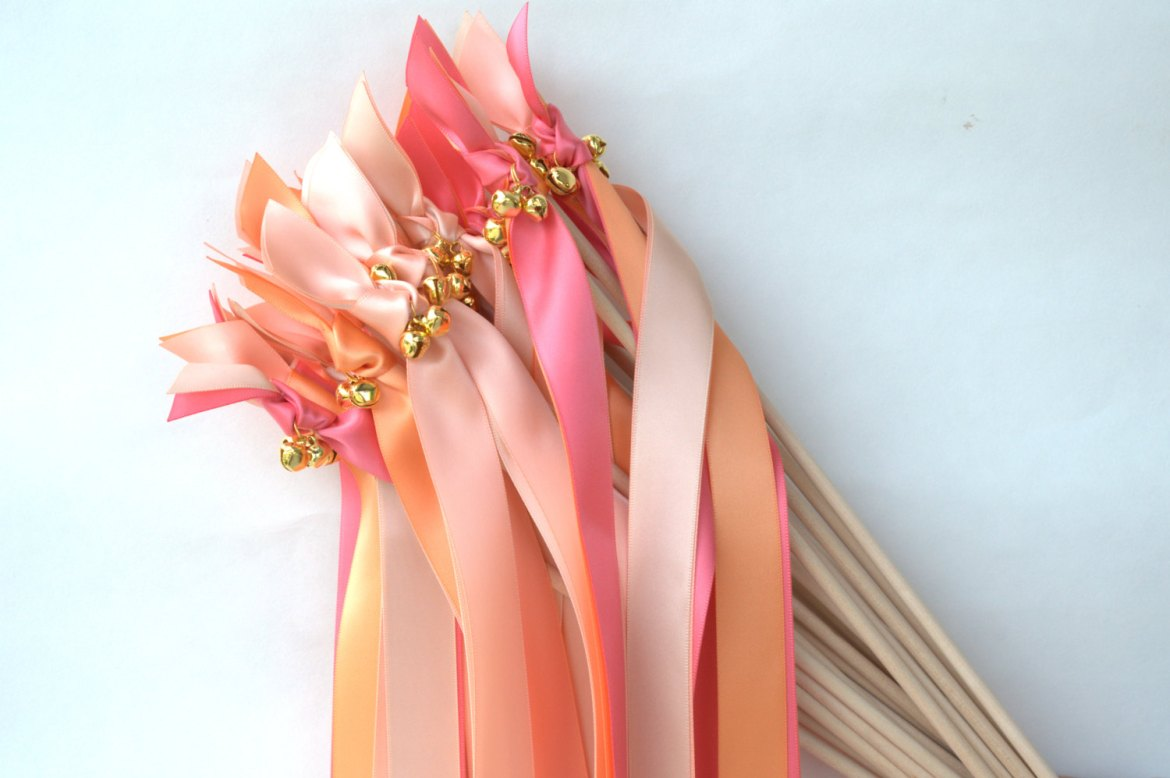 orange pink ribbon wands with bells