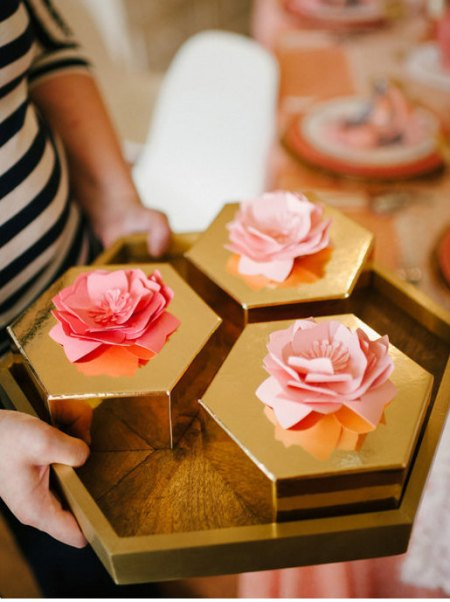 paper flowers on gold boxes