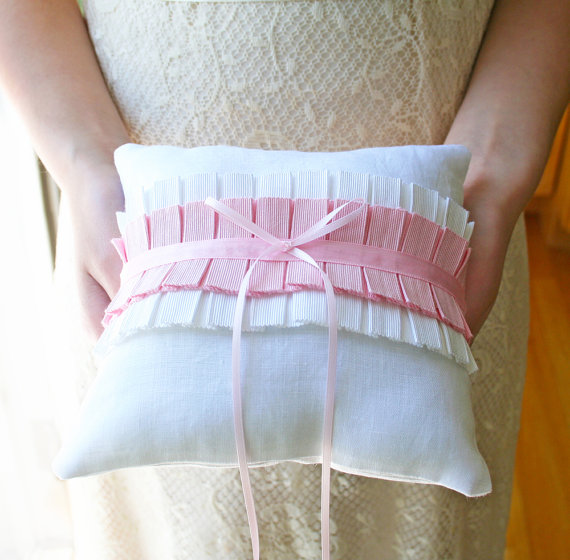 pink pleats ring pillow via 8 Chic Linen Ring Pillows