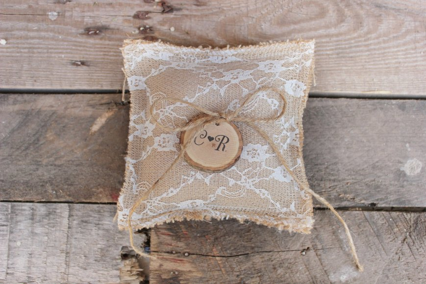 burlap ring pillow with lace overlay | via Rustic Ring Pillows http://emmalinebride.com/ceremony/rustic-ring-pillows/