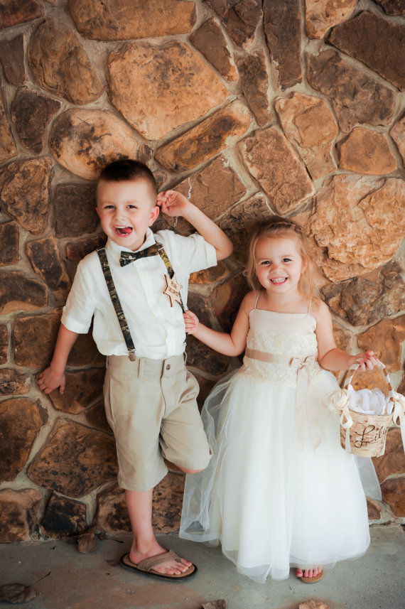 ring bearer wearing badge with flower girl