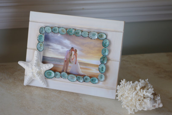 starfish and limpet shell frame | via starfish wedding ideas: http://emmalinebride.com/beach/starfish-wedding-ideas/