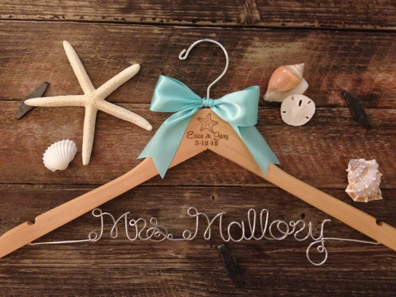 beach inspired hanger for the bridal gown photos | via starfish wedding ideas: http://emmalinebride.com/beach/starfish-wedding-ideas/
