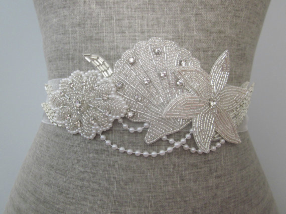 starfish wedding dress sash | via starfish wedding ideas: http://emmalinebride.com/beach/starfish-wedding-ideas/