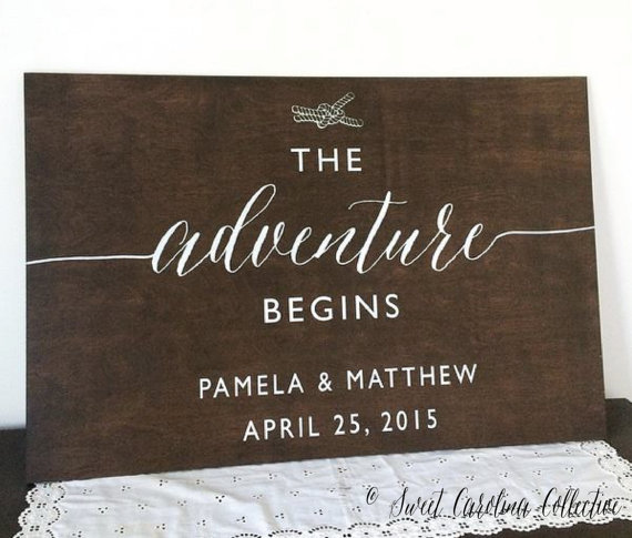 the adventure begins nautical welcome wedding sign by sweetnccollective