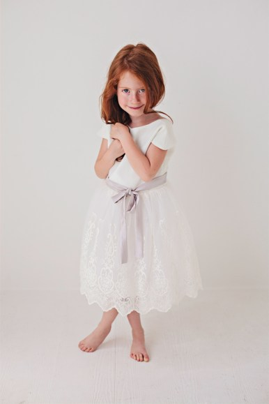 white lace flower girl dress with light purple bow sash