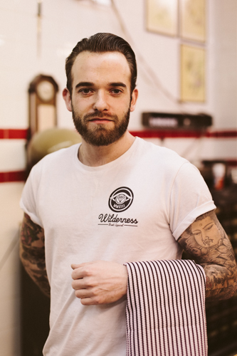Neil, barber at Rocket Barber Shop, Stoke Newington, on its opening day