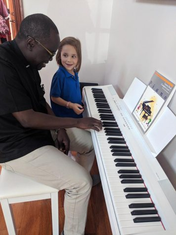 Fr Joseph, an accomplished pianist and organist, teaching Penelope