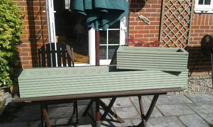 2 made window boxes from decking and painted light green