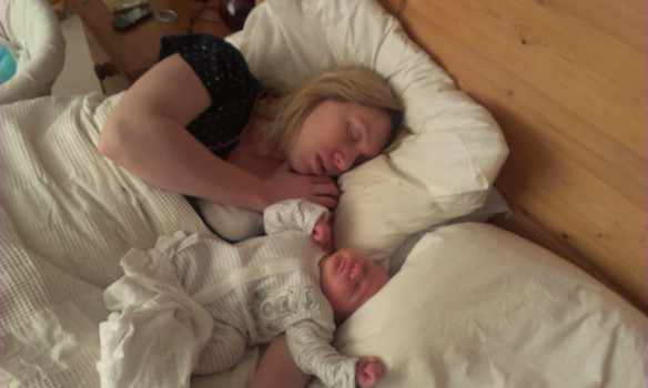 Mum in bed with baby