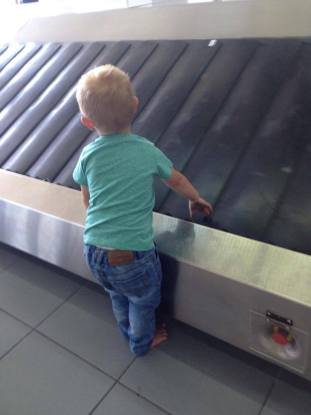 toddler at baggage claim