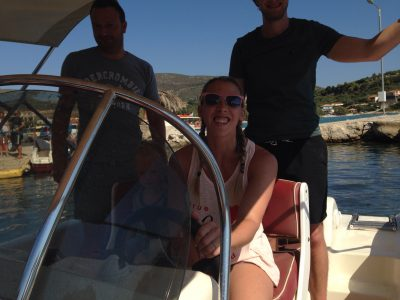 three people on a boat