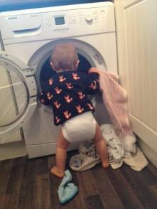 baby emptying washing machine