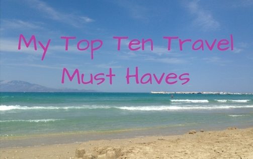 my top ten travel must haves written across a beach