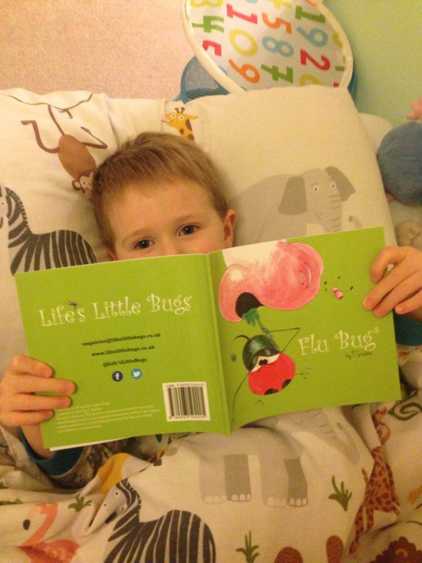 child in bed reading flu bug from life's little bugs