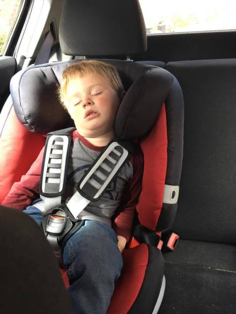 child asleep in car seat