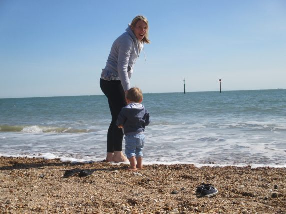 Mum and son paddling in sea