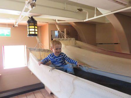 boy in hammock on a ship