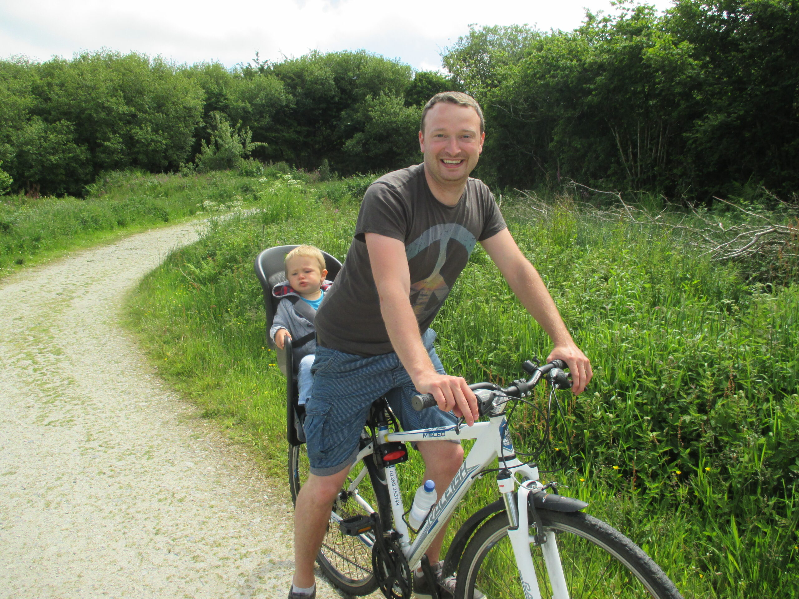 child and father on bike