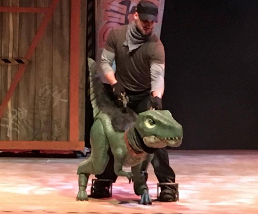small dinosaur on stage
