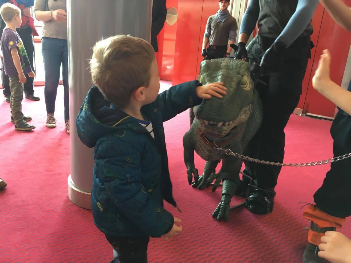 Jake stroking the dinosaur
