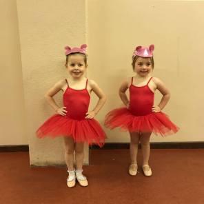 2 girsl in ballerina outfits