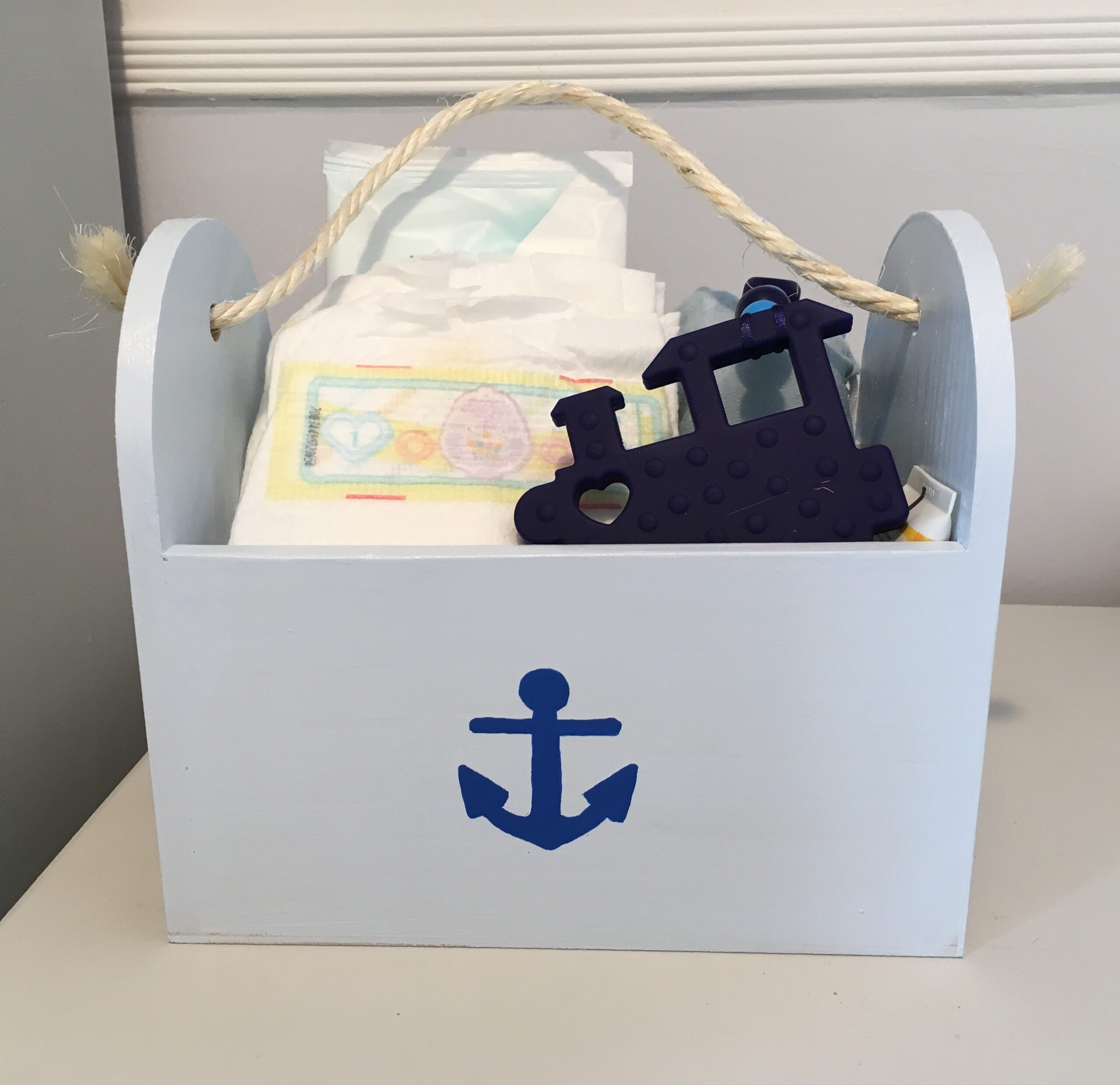 nautical themed wooden box with nappies in
