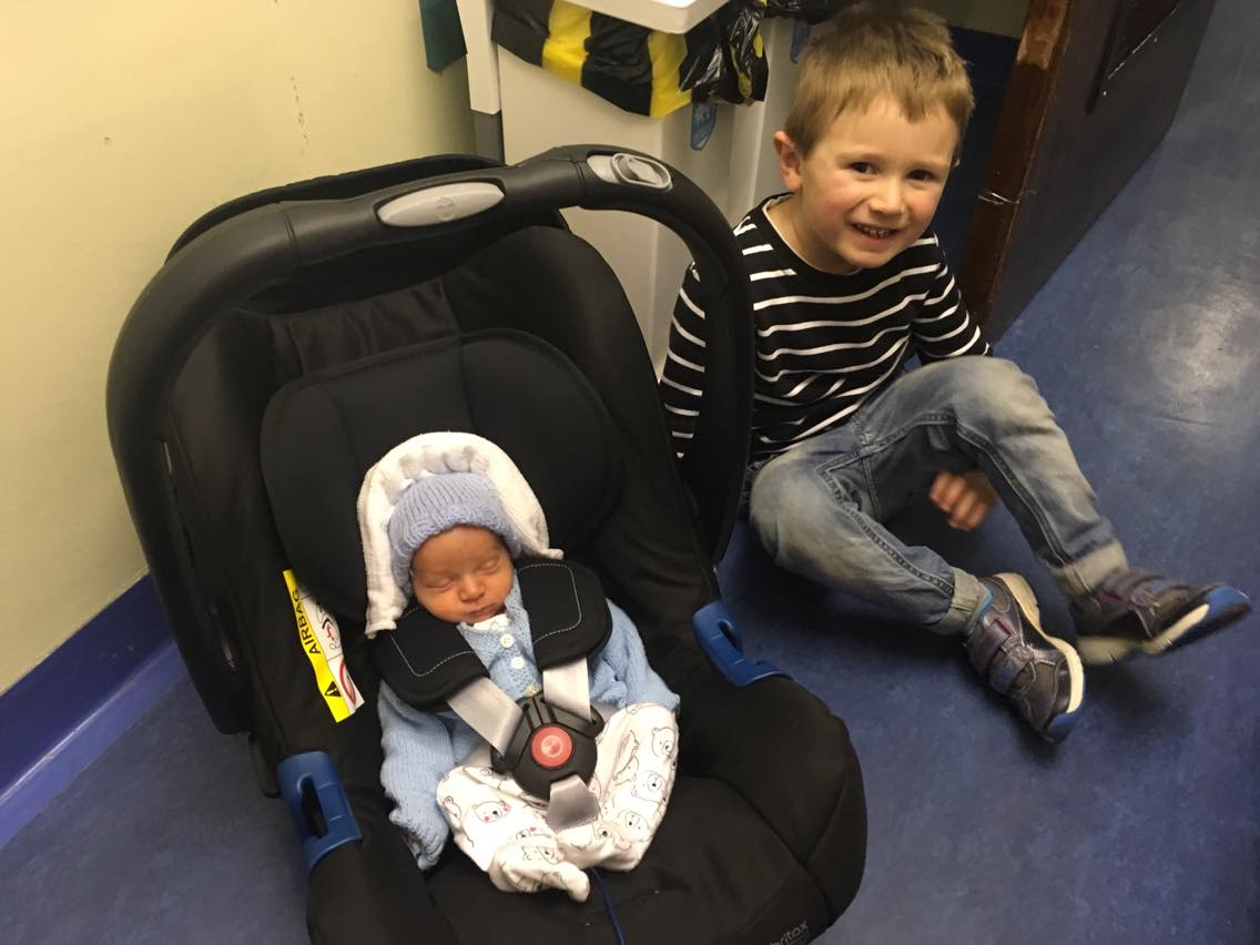 Jake and William with William in his car seat