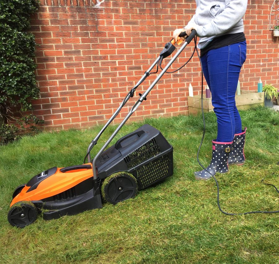 me standing with the lawnmower in the garden
