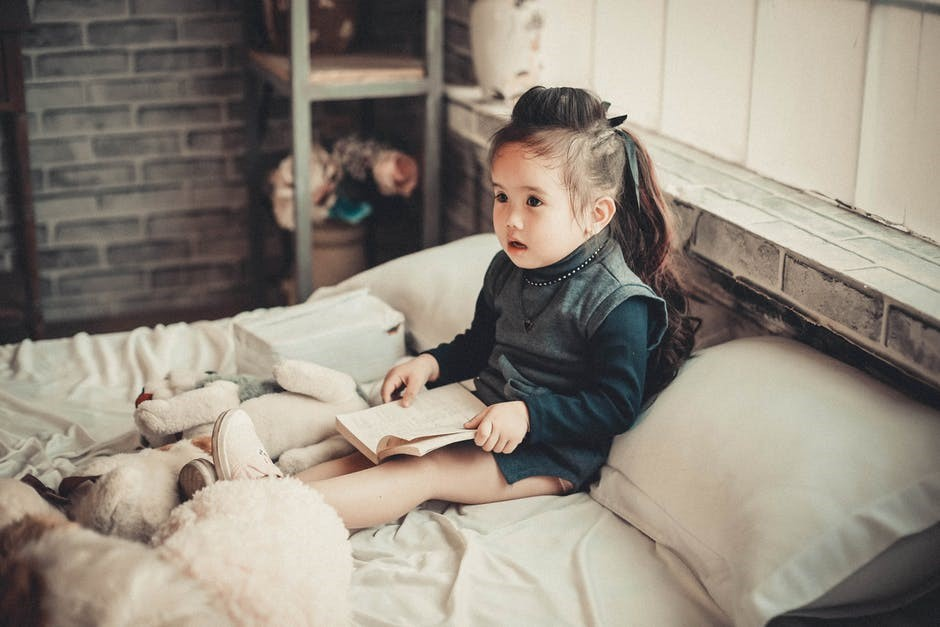 child on bed