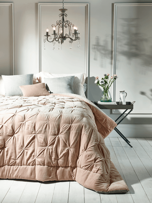 bed with scatter cushions
