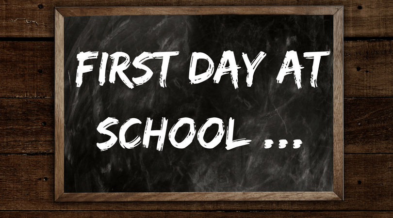 first day at school written on a chalk board