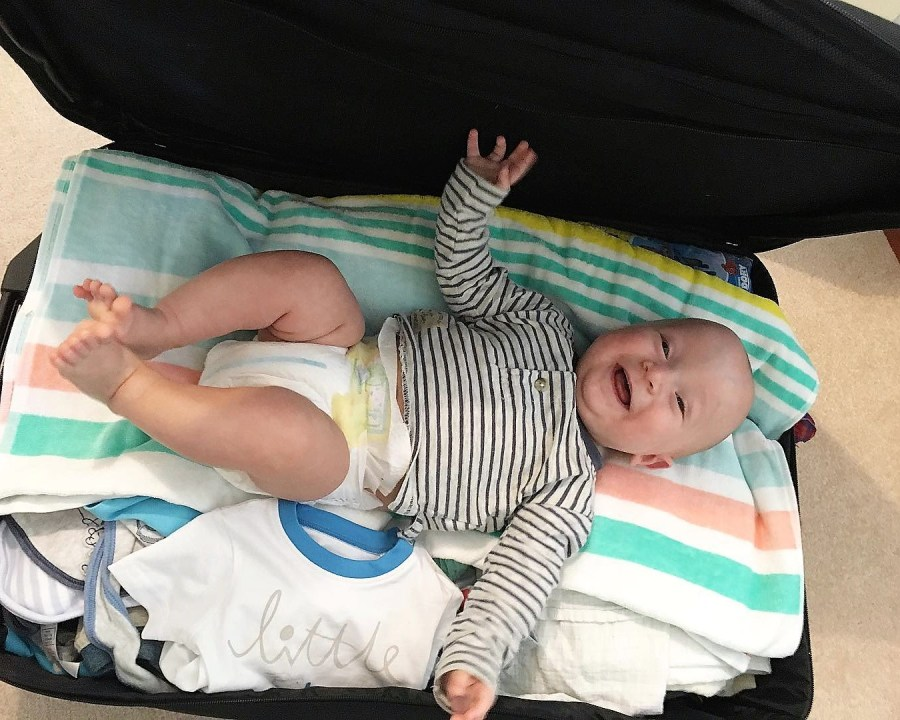 baby in luggage