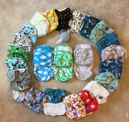 reusable nappies in a circle on the floor