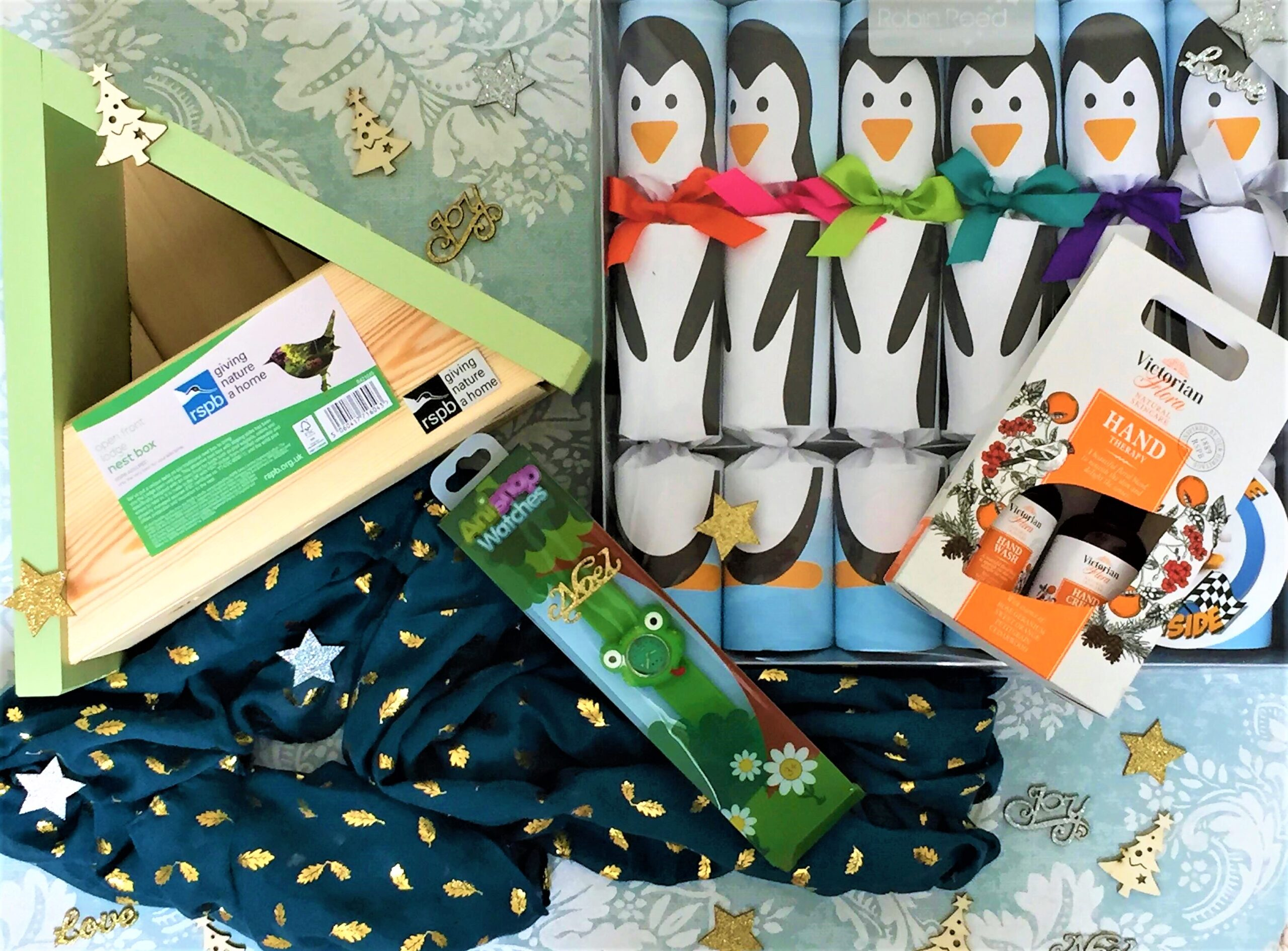 a selection of Christmas gifts and crackers