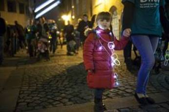 Bliss premature charity little lights walk child with lights on her at night