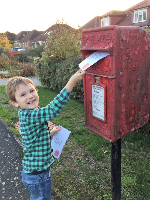 Jake posting his letter to santa at a red letter box