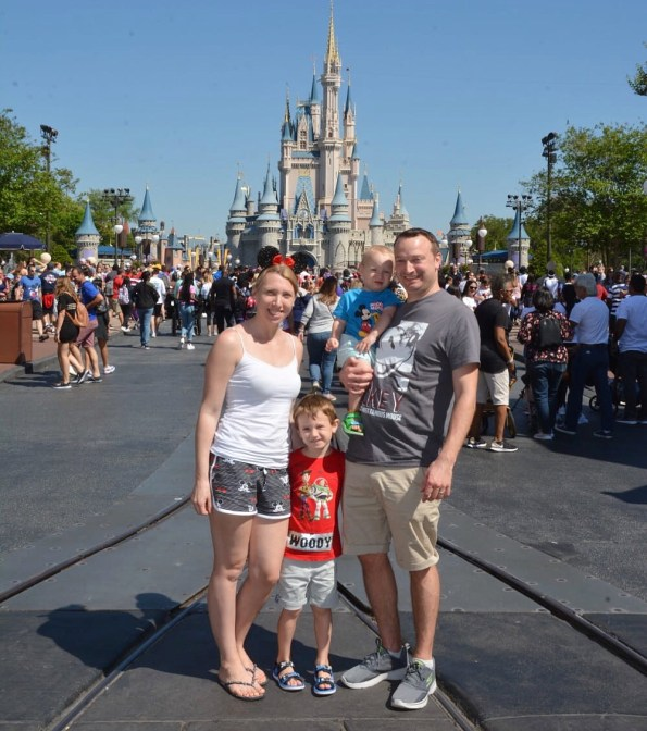 my family standing outside the castle at Disney World