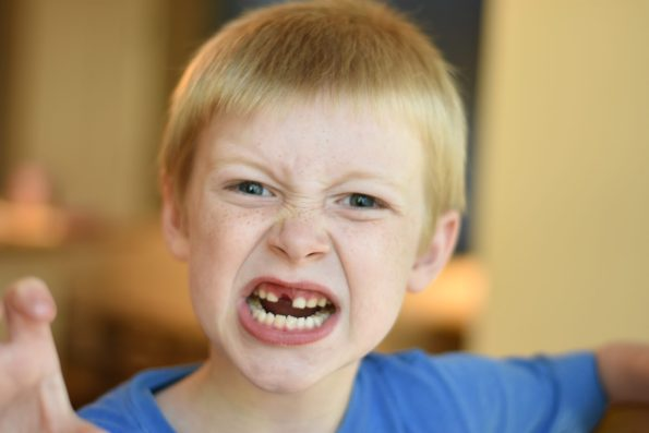 child making a face in anger