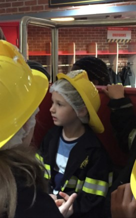 Jake in the back of the fire engine