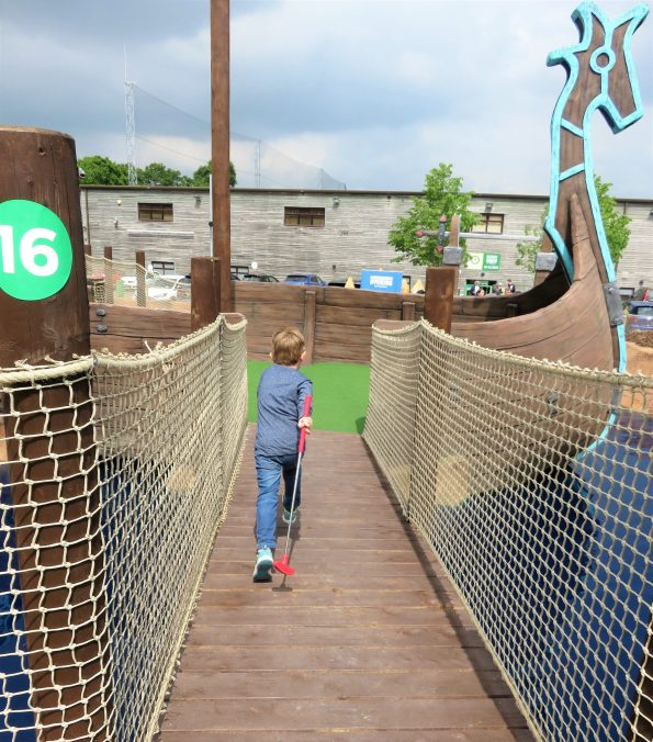 Jake running across the bridge at mighty claws adventure golf